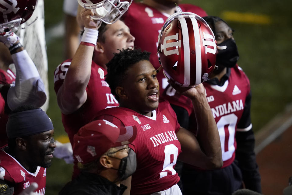 Indiana quarterback Michael Penix Jr. (9) celebrates after Indiana defeated Penn State in overtime of an NCAA college football game, Saturday, Oct. 24, 2020, in Bloomington, Ind. Indiana won 36-35 in overtime. (AP Photo/Darron Cummings)