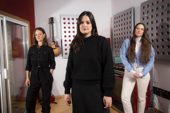 "Folk group, The Staves, from left, sisters, Emily, Jessica and Camilla Staveley-Taylor pose in a north London recording studio to promote their album ""Good Woman"", on Monday, Feb. 15, 2021. (Photo by Joel C Ryan/Invision/AP)"