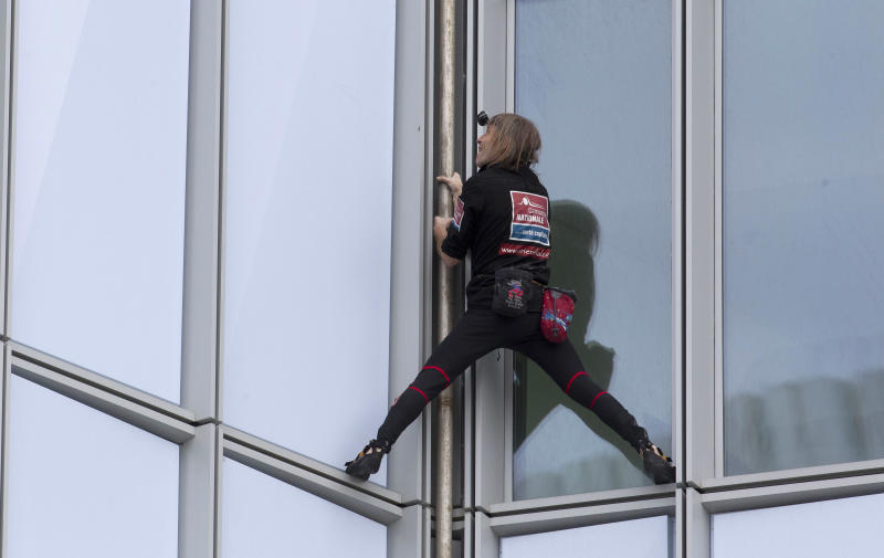 French urban climber Alain Robert, known as 'Spiderman', climbs up the 231 meter high (758 feet) First Tower, the tallest skyscraper in France, in the La Defense business district in Courbevoie, outside Paris, Thursday, May 10, 2012. (AP Photo/Michel Euler)