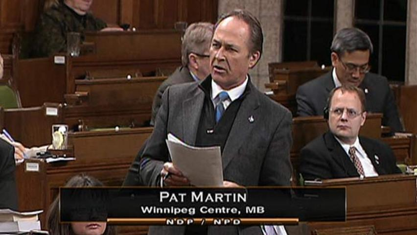 Winnipeg NDP MP Pat Martin bids a not-so-fond farewell to the Canadian penny, during members statements before question period in the House of Commons on Monday.