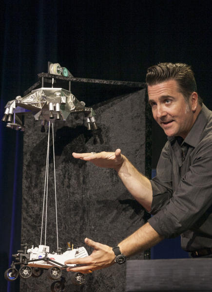 Adam Steltzner, Mars Science Laboratory's entry, descent and landing phase leader at JPL uses a scale model to explains the Curiosity rover's Entry, Descent, and Landing (EDL) during the Mission Engineering Overview news briefing at NASA's Jet Propulsion Laboratory in Pasadena, Calif., Thursday, Aug. 2, 2012. Curiosity is scheduled to land on Mars Sunday night. (AP Photo/Damian Dovarganes)
