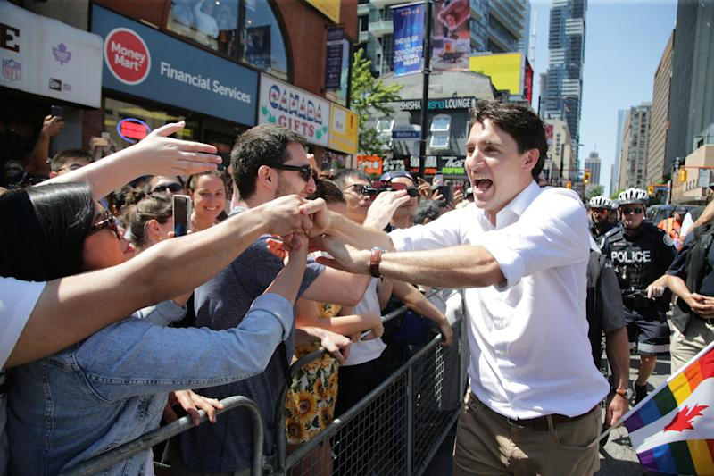 Prime Minister Justin Trudeau greets people as he joins supporters of Toronto's LGBTQ community as they march in one of North America's largest Pride parades, in Toronto on June 23, 2019.  (Photo: Chris Helgren / Reuters)