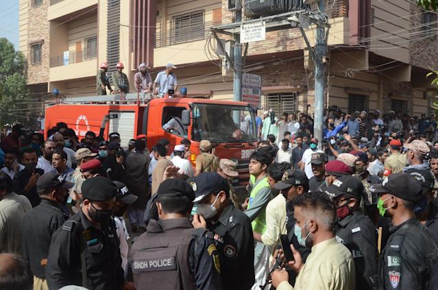 KARACHI, PAKISTAN, MAY 22: Pakistani people arrive at the site of a passenger plane crash in Karachi, Pakistan, May 22, 2020. A Pakistani passenger plane with at least 100 people on board crashed in a residential area in the Pakistani city of Karachi on Friday, the country's civil aviation agency said. (Photo by H.KHAN/Anadolu Agency via Getty Images)