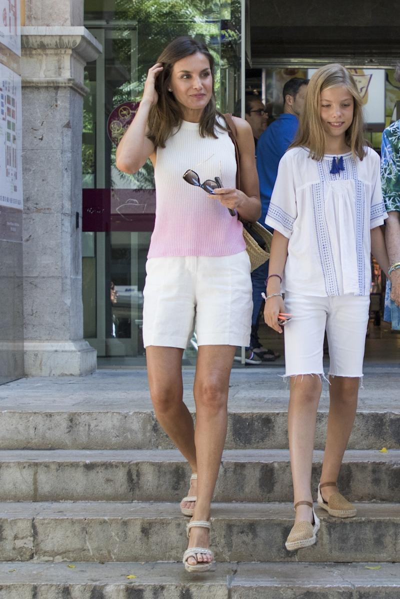 Who: Queen Letizia of Spain What: Mango top, Whitelily bag, De Cos shoes, Carolina Herrera sunglasses Where: On the street, Mallorca, Spain When: July 31, 2018