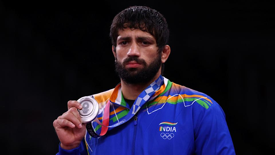 Tokyo 2020 Olympics - Wrestling - Freestyle - Men's 57kg - Medal Ceremony - Makuhari Messe Hall A, Chiba, Japan - August 5, 2021. Silver medallist Ravi Kumar of India poses with his medal. REUTERS/Leah Millis