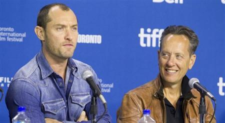 """Actors Jude Law and actor Richard E. Grant attend a news conference for the film """"Dom Hemingway"""" at the 38th Toronto International Film Festival"""
