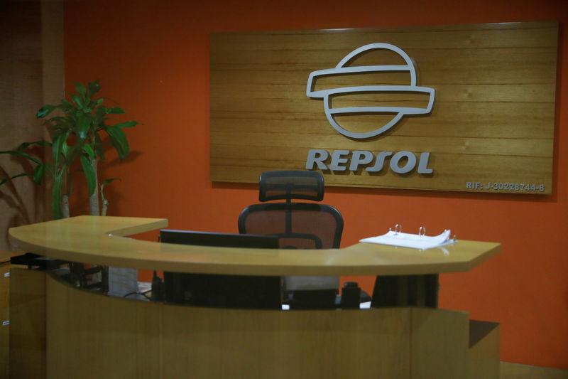 FILE PHOTO: The corporate logo of Repsol is seen in their office in Caracas, Venezuela April 25, 2017. REUTERS/Carlos Garcia Rawlins/File Photo