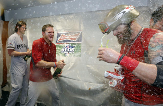 Boston Red Sox's players celebrate their victory over the Tampa Bay Rays in Game 4 of an American League baseball division series, Wednesday, Oct. 9, 2013, in St. Petersburg, Fla. The Boston Red Sox's defeated the Tampa Bay Rays 3-1 to move on to the American League Championship Series. (AP Photo/Mike Carlson)