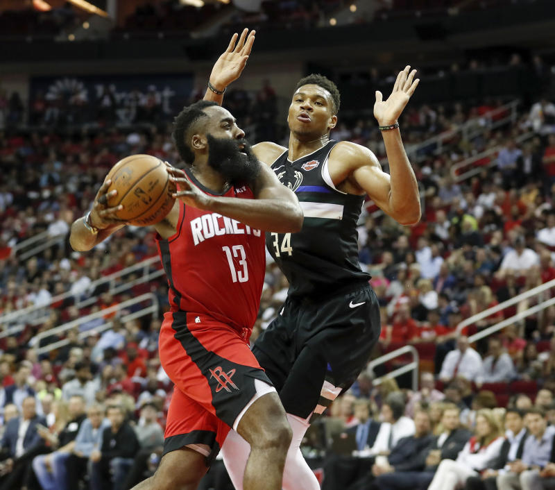 Houston's James Harden drives to the basket defended by Milwaukee's Giannis Antetokounmpo at Toyota Center on Oct. 24, 2019. (Photo by Tim Warner/Getty Images)