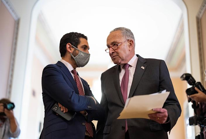 Senate Majority Leader Chuck Schumer, D-N.Y., talks to an aide following a Democratic policy luncheon at the U.S. Capitol on Sept. 28, 2021 in Washington, D.C.