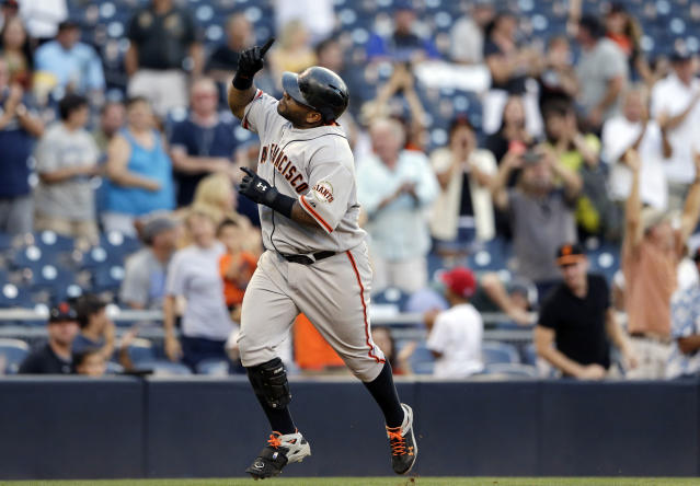 San Francisco Giants' Pablo Sandoval rounds third base after hitting his third home run of a baseball game against the San Diego Padres during the ninth inning on Wednesday, Sept. 4, 2013, in San Diego. (AP Photo/Gregory Bull)