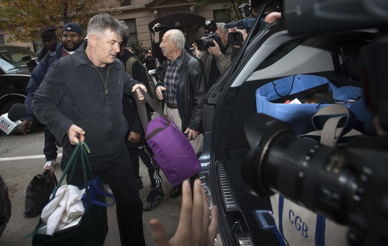 Actor Alec Baldwin loads bags into his SUV outside his apartment in New York