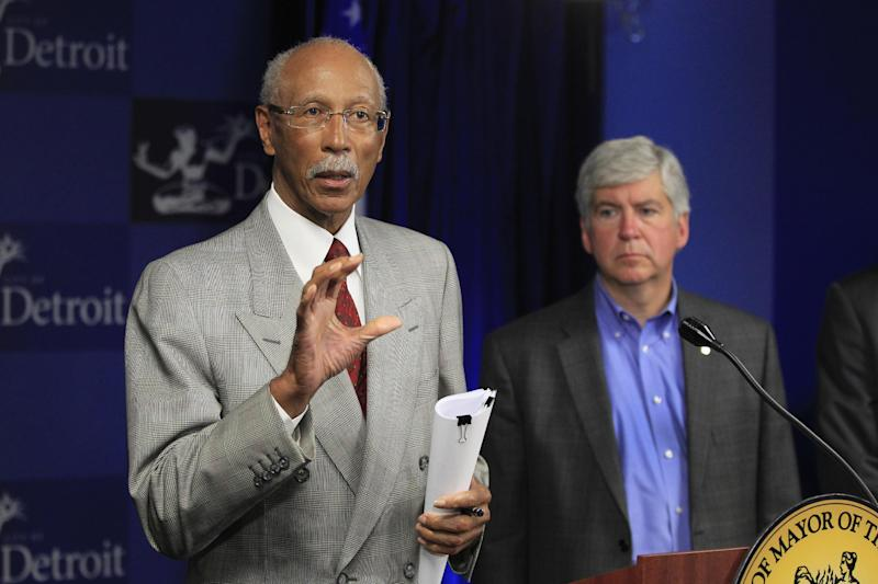 Detroit Mayor Dave Bing, left, and Gov. Rick Snyder address the media during a news conference in the mayor's office in Detroit, Monday, June 4, 2012. City and state officials, along with a cadre of influential business leaders, will spend the next two months coming up with answers posed by federal Transportation Secretary Ray LaHood on a proposed Detroit light rail project. (AP Photo/Carlos Osorio)