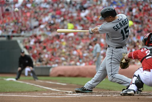 Seattle Mariners' Kyle Seager hits a two-run home run in the first inning of a baseball game against the Cincinnati Reds at Great American Ball Park in Cincinnati, Saturday, July 6, 2013. (AP Photo/Michael E. Keating)