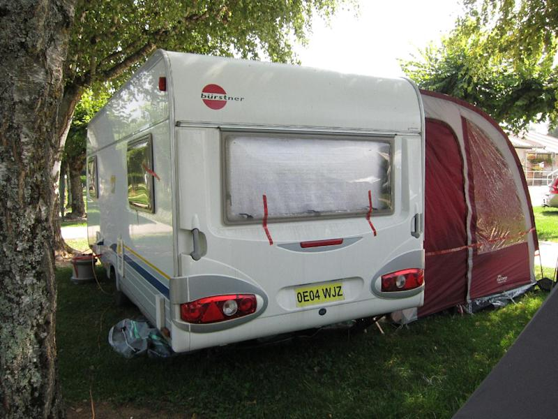 view of the trailer where the slain British family were holidaying in a camp site of Saint Jorioz, near Annecy, French Alps, Friday, Sept. 7, 2012. French prosecutors focused Friday on a feud between brothers as they searched for a motive in the slayings of a British-Iraqi family vacationing in the French Alps. Two young sisters survived the deaths of their parents and an older woman in the family car late Wednesday, as well as a French cyclist whose body was found nearby. (AP Photo/Lionel Cironneau)