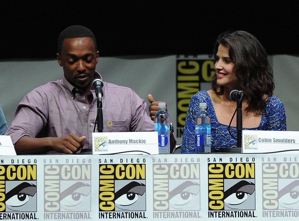 "SAN DIEGO, CA - JULY 20:  Actors Anthony Mackie (L) and Cobie Smulders speak onstage at Marvel Studios ""Thor: The Dark World"" and ""Captain America: The Winter Soldier"" during Comic-Con International 2013 at San Diego Convention Center on July 20, 2013 in San Diego, California.  (Photo by Kevin Winter/Getty Images)"