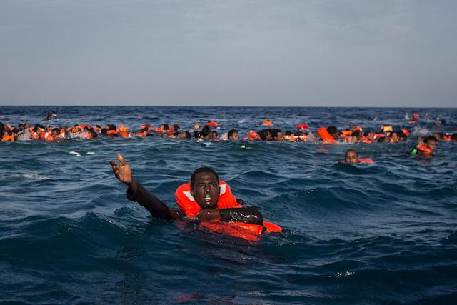 <p>Refugees and migrants are seen swimming and yelling for assistance from crew members from the Migrant Offshore Aid Station (MOAS) 'Phoenix' vessel after a wooden boat bound for Italy carrying more than 500 people capsized on May 24, 2017 off Lampedusa, Italy. Photo: Chris McGrath/Getty Images) </p>