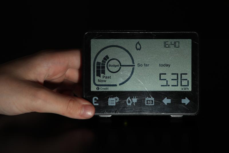A person holds a smart meter. (Photo by Peter Byrne/PA Images via Getty Images)