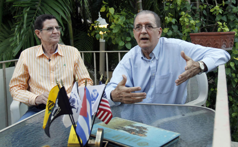 Jose Ignacio Castro Toirac, left, listens as his brother Julio De-Castro Toirac recounts the events that took place during the Cuban Missile Crisis in Oct., 1962, in Coral Gables, Fla., Thursday, Oct. 11, 2012. Unbeknownst to one another, Julio and Jose Castro had both enlisted in the military, the older brother with the United States, the younger with Cuba. As the U.S. and the Soviets inched closer to catastrophe 50 years ago this week, one brother stood in the trenches in Cuba while the other awaited orders in Miami. (AP Photo/Alan Diaz)