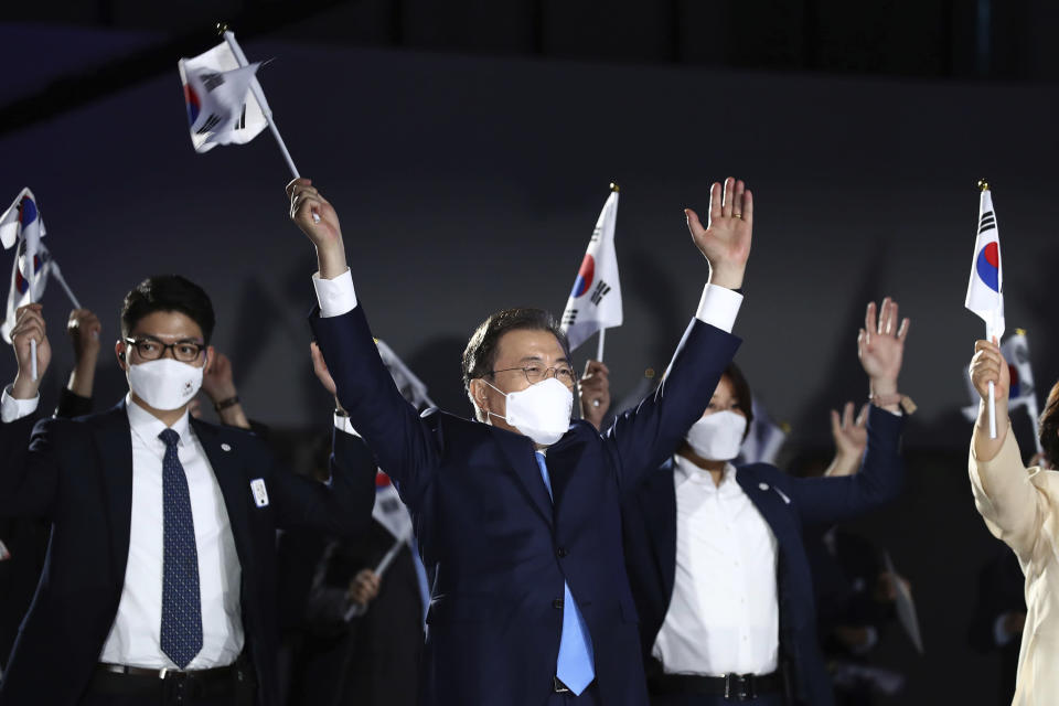 South Korean President Moon Jae-in, center, gives three cheers during the celebration of 75th anniversary of the Liberation Day at Dongdaemun Design Plaza in Seoul Saturday, Aug. 15, 2020. (Chung Sung-jun/Pool Photo via AP)