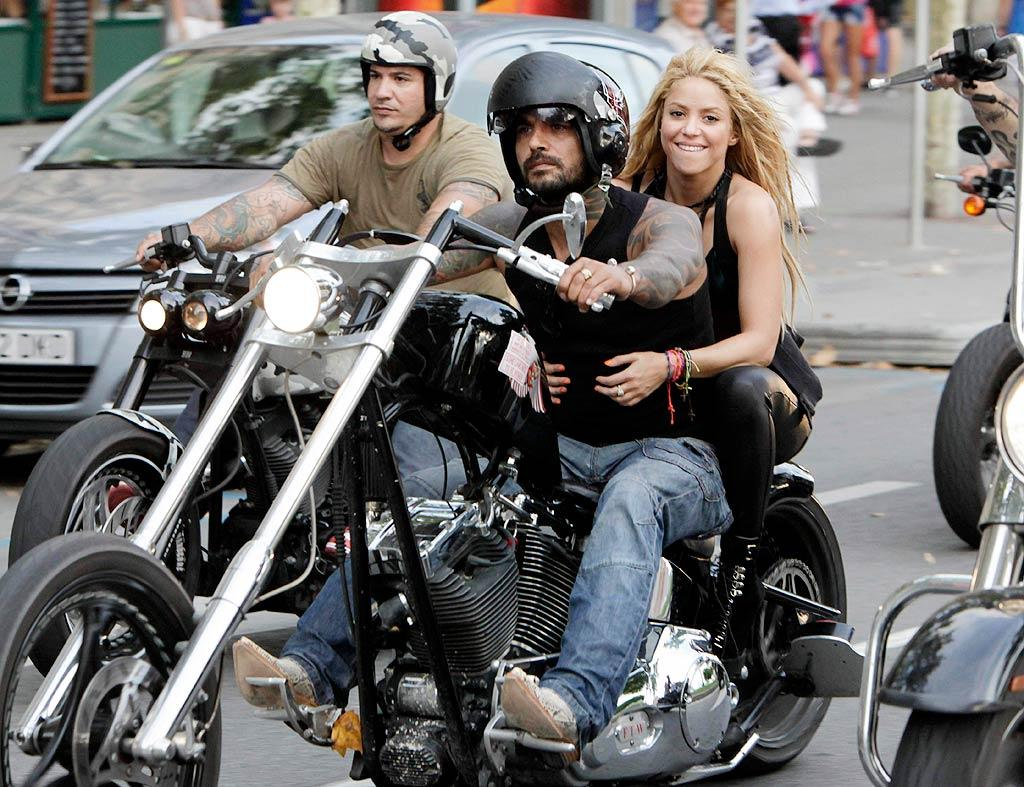 """After a quick costume change, the 32-year-old hitched a ride on a Harley with a tattooed gentleman. Shakira is due to kick off her world tour September 15 in Montreal, Canada, before making her way through the USA. Will you be attending the show? OHPIX/<a href=""""http://www.x17online.com"""" target=""""new"""">X17 Online</a> - August 17, 2010"""
