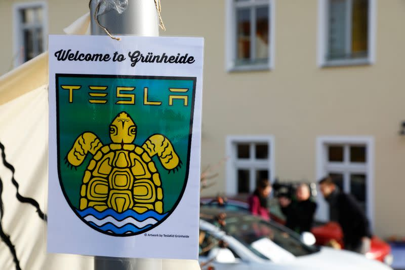 A pro-Tesla poster is seen during an action to support plans by U.S. electric vehicle pioneer Tesla to build its first European factory and design center in Gruenheide near Berlin