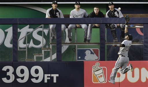 Members of the Chicago White Sox bullpen watch center fielder Alejandro De Aza leaping for New York Yankees' Alex Rodriguez's fifth-inning RBI-double during a baseball game at Yankee Stadium in New York, Thursday, June 28, 2012. (AP Photo/Kathy Willens)