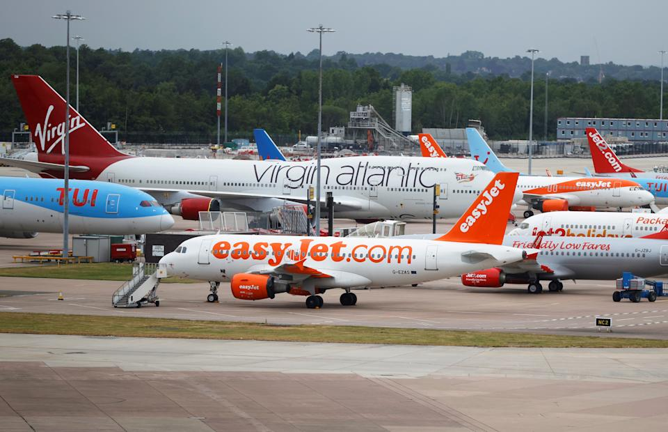 Easyjet, Virgin Atlantic and TUI Airways aircraft are seen at Manchester Airport, following the outbreak of the coronavirus disease (COVID-19), Manchester, Britain, June 8, 2020. REUTERS/Phil Noble