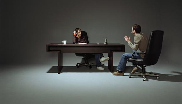 Two men having discussion at desk