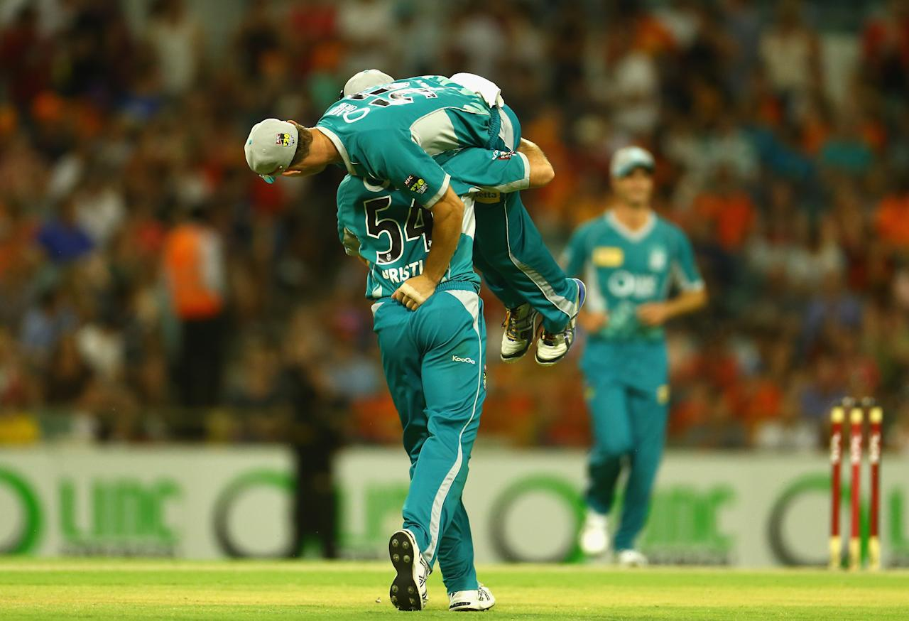 PERTH, AUSTRALIA - JANUARY 19: Dan Christian and Chris Lynn of Brisbane Heat celebrate after they defeated the Scorchers in the Big Bash League final match between the Perth Scorchers and the Brisbane Heat at the WACA on January 19, 2013 in Perth, Australia.  (Photo by Robert Cianflone/Getty Images)