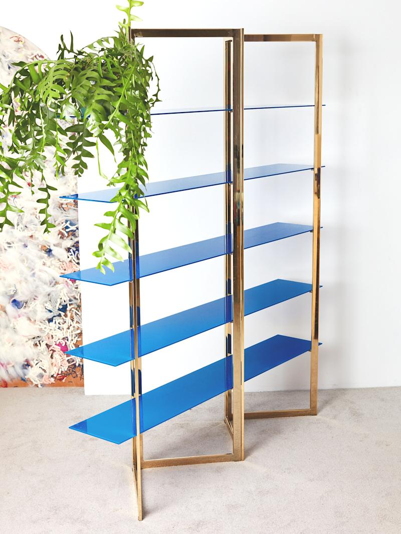 We love this vintage accordion-style brass étagère with painted blue shelves.