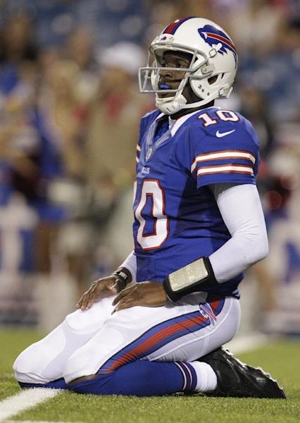 File - In this Aug. 25, 2012 file photo, Buffalo Bills' Vince Young kneels on the turf after throwing an interception against the Pittsburgh Steelers during the second half of a preseason NFL football game in Orchard Park, N.Y. Six years after entering the NFL as the third player taken in the draft, Young finds himself without a team and with only a fraction of the money he received from a contract that paid him a guaranteed $26 million. (AP Photo/Gary Wiepert, File)