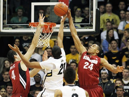 Stanford forward Josh Huestis, right, reaches up to block a shot by Colorado forward Andre Roberson, center, as Stanford center Stefan Nastic covers in the first half of an NCAA college basketball game in Boulder, Colo., Thursday, Feb. 23, 2012. (AP Photo/David Zalubowski)