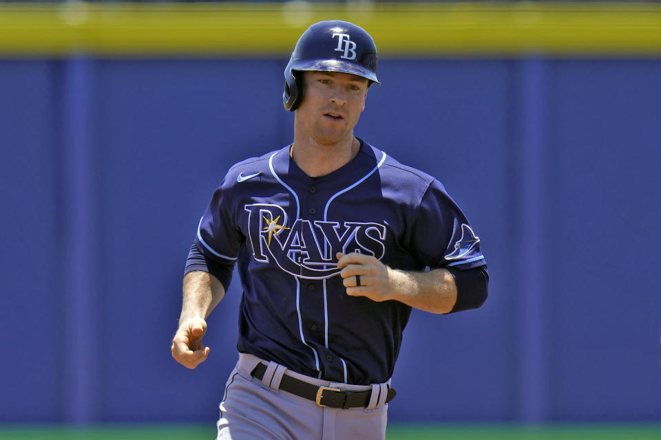 Tampa Bay Rays' Joey Wendle runs around the bases after his grand slam off Toronto Blue Jays starting pitcher Trent Thornton during the first inning of a baseball game Monday, May 24, 2021, in Dunedin, Fla. (AP Photo/Chris O'Meara)