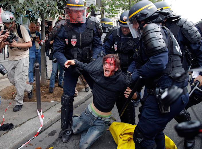 <p>SEPT. 15, 2016 — A wounded demonstrator is being evacuated by riot police following scuffles between protesters and the police as part of a protest against a labor law, in Paris, France. Police With strikes and protests, French unions are staging a last-ditch bid to dismantle a labor law that weakens their powers and worker protections. (AP Photo/Christophe Ena) </p>