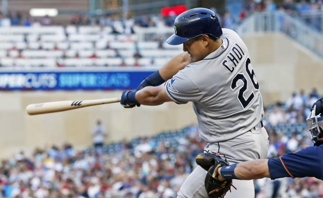 Tampa Bay Rays' Ji-Man Choi follows through on a single off Minnesota Twins pitcher Jake Odorizzi during the fourth inning of a baseball game Wednesday, June 26, 2019, in Minneapolis. (AP Photo/Jim Mone)