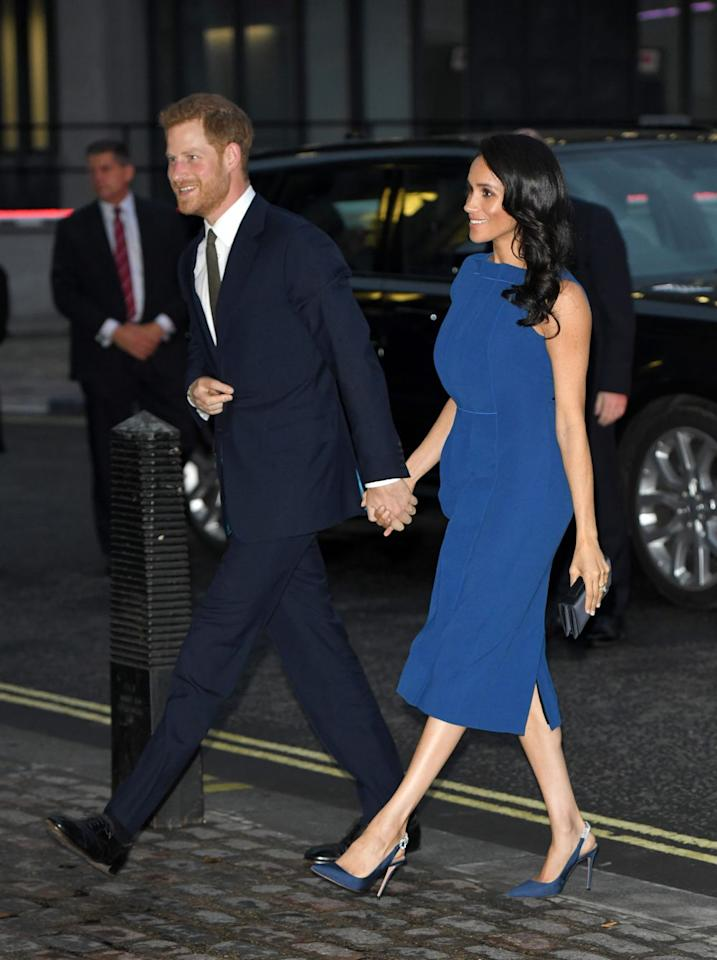 <p>Meghan opted for a head-to-toe royal blue outfit to attend a charity concert in London with Prince Harry. Her sleeveless dress was by designer Jason Wu and she paired it with matching blue heels by her favourite shoe designer, Aquazzura.</p>