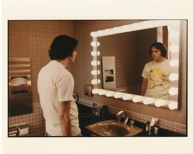Jim Carrey stares at his Andy Kaufman reflection in <em>Jim & Andy</em>. (Photo: Netflix)