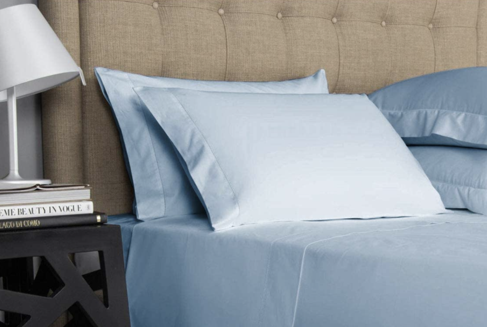 Mayfair Linen's 100% Egyptian Cotton Sheet Set  - Amazon. A photo of a stylish bedside table and cotton sheets
