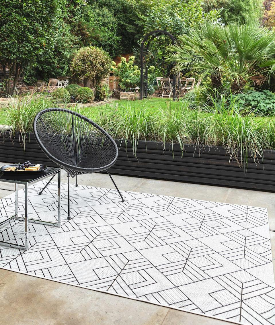 """<p>As extensions of our homes, our outdoor spaces are becoming 'rooms', and so there's a need to bring that cosy feeling into the garden. An easy way to do this is to invest in an <a href=""""https://www.housebeautiful.com/uk/garden/g32728371/outdoor-rugs/"""" rel=""""nofollow noopener"""" target=""""_blank"""" data-ylk=""""slk:outdoor rug"""" class=""""link rapid-noclick-resp"""">outdoor rug</a>. Inject some personality into your space with a pop of colour or bold pattern – and it will help to zone your space, too. To accessorise, add some <a href=""""https://www.housebeautiful.com/uk/garden/g32577683/garden-lanterns/"""" rel=""""nofollow noopener"""" target=""""_blank"""" data-ylk=""""slk:garden lanterns"""" class=""""link rapid-noclick-resp"""">garden lanterns</a> and <a href=""""https://www.housebeautiful.com/uk/garden/g32139876/outdoor-cushions/"""" rel=""""nofollow noopener"""" target=""""_blank"""" data-ylk=""""slk:outdoor cushions"""" class=""""link rapid-noclick-resp"""">outdoor cushions</a></p><p><strong>Pictured: </strong>Patio Flatweave Rugs in Deco Ivory, <a href=""""https://go.redirectingat.com?id=127X1599956&url=https%3A%2F%2Fwww.therugseller.co.uk%2Fpatio-flatweave-rugs-pat16-deco-ivory%2Fp-50-6138-12975-15&sref=https%3A%2F%2Fwww.housebeautiful.com%2Fuk%2Fgarden%2Fdesigns%2Fg28%2Fgarden-ideas-on-a-budget%2F"""" rel=""""nofollow noopener"""" target=""""_blank"""" data-ylk=""""slk:The Rug Seller"""" class=""""link rapid-noclick-resp"""">The Rug Seller</a> </p>"""
