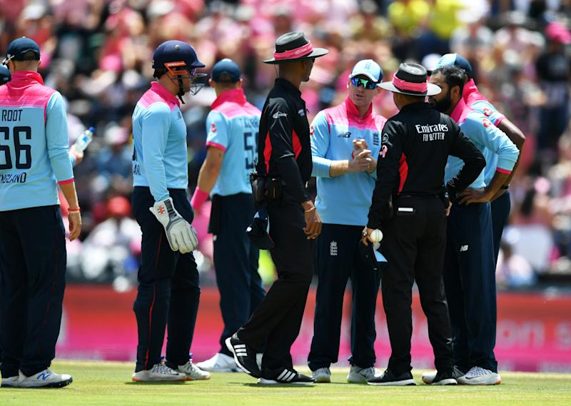 Eoin Morgan of England (C) speaks to the umpires as Rassie van der Dussen of South Africa is given not out on review during the 3rd One Day International match between England and South Africa on February 09, 2020 in Johannesburg, South Africa.