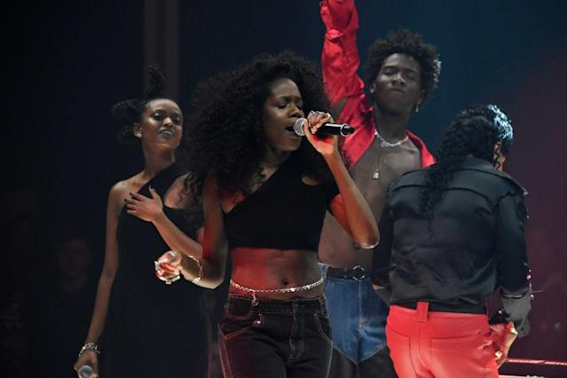 <p>Musicians wear designs from Telfar's fall collection, including a black dress, crop top, red jacket, flare jeans, and leather & denim hybrid jeans. (Photo: Getty) </p>