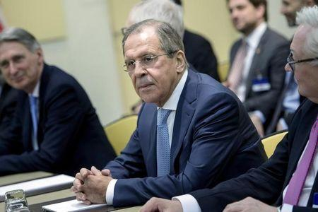 Russian Foreign Minister Lavrov waits with others for a P5+1 meeting in Lausanne