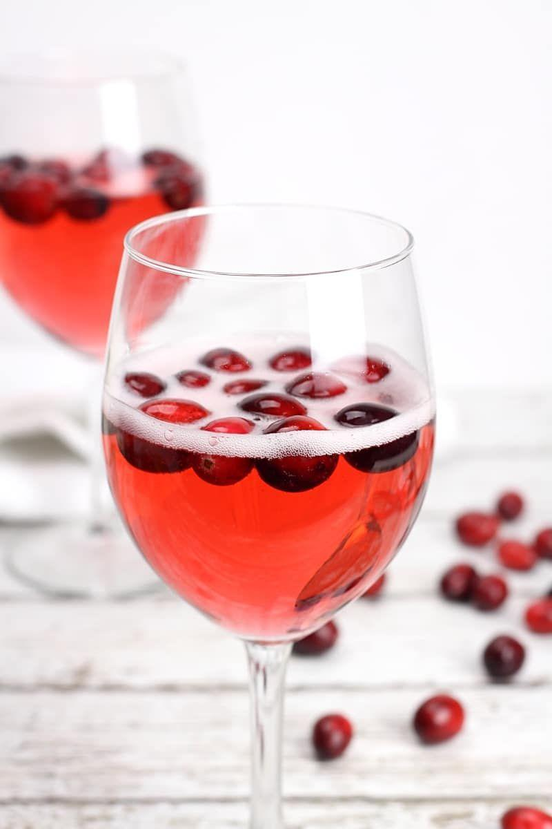 """<p>This fruity alcoholic drink has a hint of orange and a touch of sweetness—something to please just about everyone. </p><p><em>Get the recipe at <a href=""""https://thetoastykitchen.com/cranberry-prosecco-punch/"""" rel=""""nofollow noopener"""" target=""""_blank"""" data-ylk=""""slk:The Toasty Kitchen"""" class=""""link rapid-noclick-resp"""">The Toasty Kitchen</a>. </em></p>"""