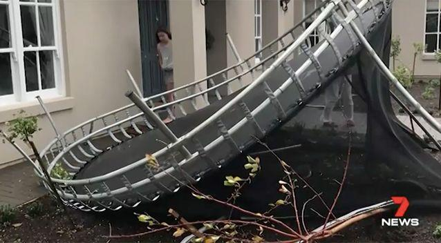 A trampoline was picked up and went flying over a two-storey house. Source: 7 News