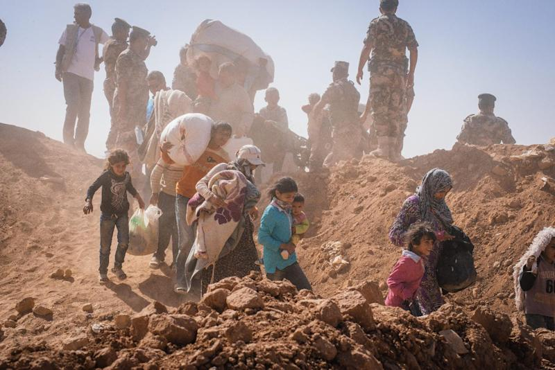 A photo released by the United Nations High Commissioner for Refugees (UNHCR) shows Syrian refugees streaming across the border into Jordan on January 22, 2014 (AFP Photo/Jared Kohler)