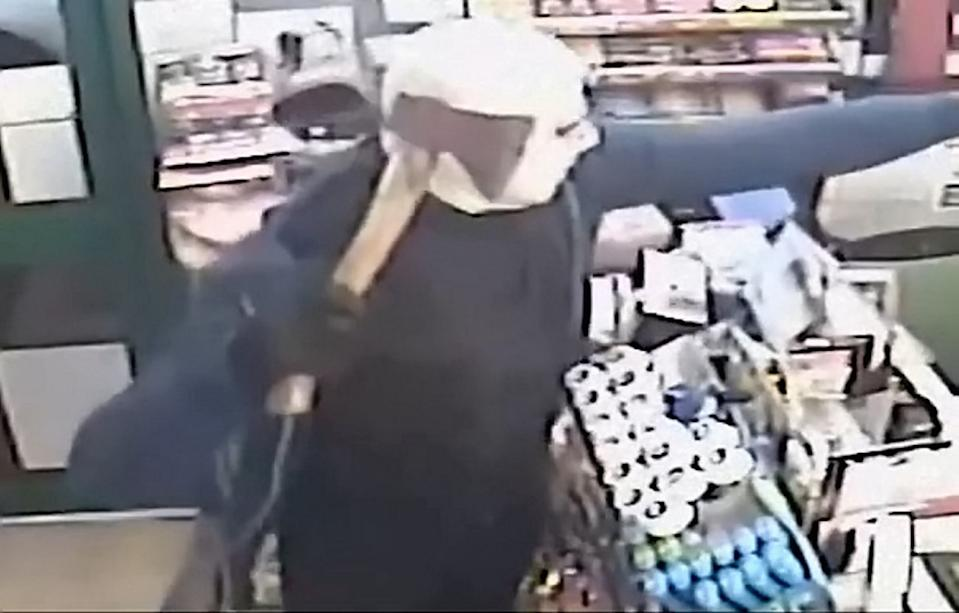 The robbers stormed into GMP Off Licence in Wednesfield, West Midlands, on December 17 (Picture: SWNS)