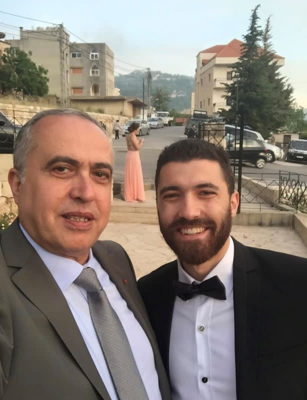 Colonel Joseph Skaf, a retired customs official who died in 2017, poses for a photo with his son, Michel Skaf in this undated handout photo in the town of Jezzine