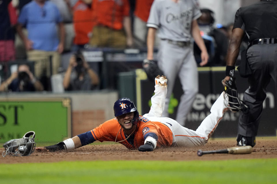 Houston Astros' Yuli Gurriel scores the game-winning run against the Chicago White Sox during the ninth inning of a baseball game Friday, June 18, 2021, in Houston. The Astros won 2-1. (AP Photo/David J. Phillip)
