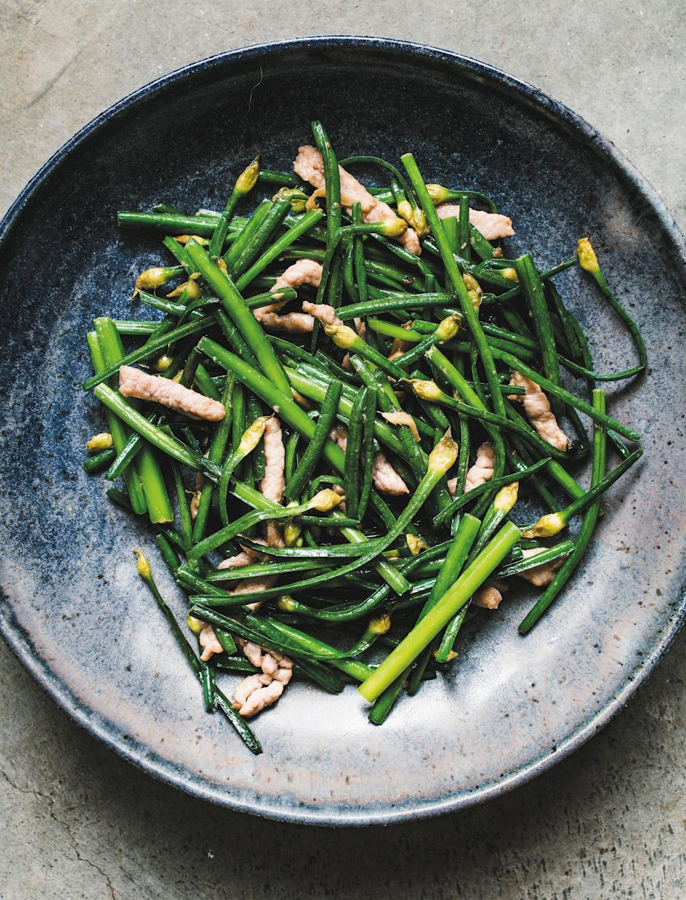 """This vibrant green dish is one of our favorite recipes from Epi contributor Betty Liu's <a href=""""https://www.epicurious.com/expert-advice/the-11-best-new-cookbooks-of-spring-2021-article?mbid=synd_yahoo_rss"""" rel=""""nofollow noopener"""" target=""""_blank"""" data-ylk=""""slk:new cookbook"""" class=""""link rapid-noclick-resp"""">new cookbook</a>, <em>My Shanghai</em>. <a href=""""https://www.epicurious.com/recipes/food/views/flowering-chives-pork-slivers-betty-liu?mbid=synd_yahoo_rss"""" rel=""""nofollow noopener"""" target=""""_blank"""" data-ylk=""""slk:See recipe."""" class=""""link rapid-noclick-resp"""">See recipe.</a>"""